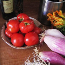 tomatoes, onions, squash blossoms at the Farmer\'s Market