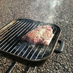 Steak on the tailgate grill
