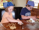 """Mary and Matt, squeezing each """"pillow"""" into an """"ear"""" of orecchiette"""